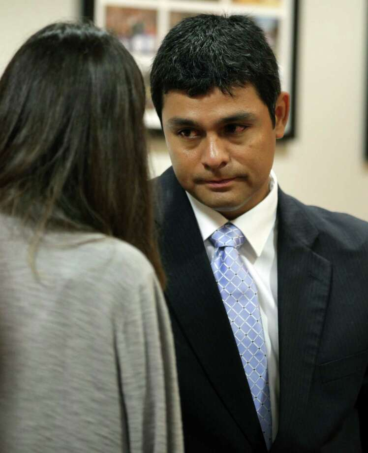 Jose Castaneda, right, a former O'Connor High School math teacher and assistant baseball coach, on trial for intoxication manslaughter, talks to a friend after he took the stand in Judge Laura Parker 386th District Court.  Thursday, May 24, 2012. Photo: BOB OWEN, San Antonio Express-News / © 2012 San Antonio Express-News