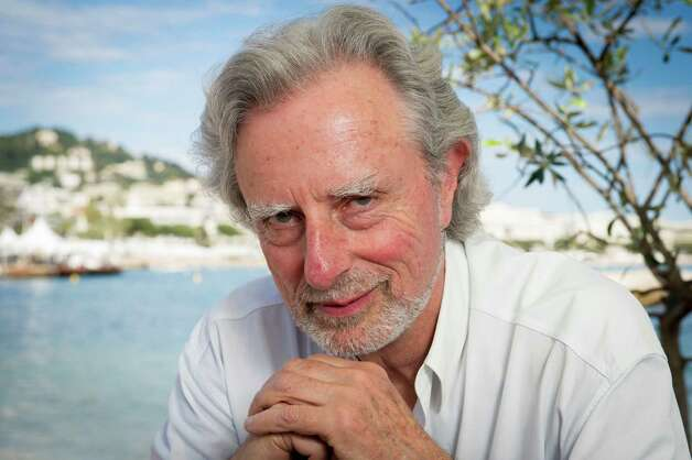 Director Philip Kaufman, poses for photographs for the film Hemingway & Gellhorn at the 65th international film festival, in Cannes, southern France, Wednesday, May 23, 2012. (AP Photo/Jonathan Short