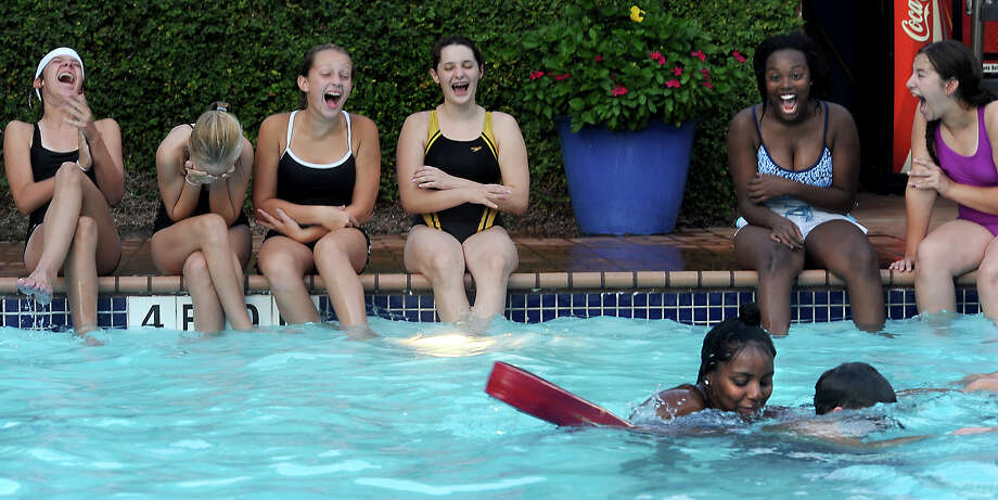 Students in the Jr. Lifeguard Program have fun while practising rescue drills in the pool at the Christus Health and Wellness Center in Beaumont, Friday. Tammy McKinley/The Enterprise Photo: TAMMY MCKINLEY