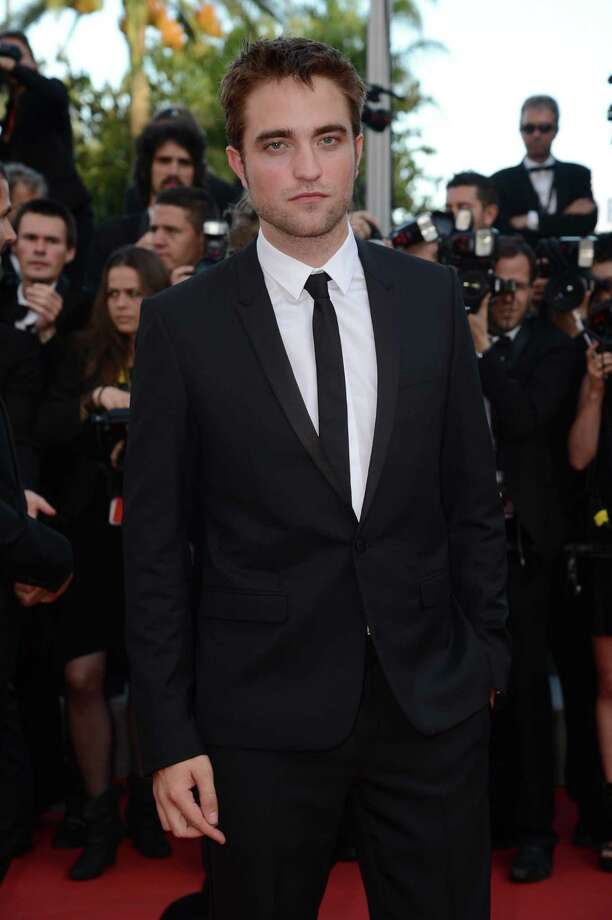 "US actor Robert Pattinson arrives for the screening of ""On the Road"" presented in competition at the 65th Cannes film festival on May 23, 2012 in Cannes.     AFP PHOTO / ANNE-CHRISTINE POUJOULATANNE-CHRISTINE POUJOULAT/AFP/GettyImages Photo: ANNE-CHRISTINE POUJOULAT / AFP"
