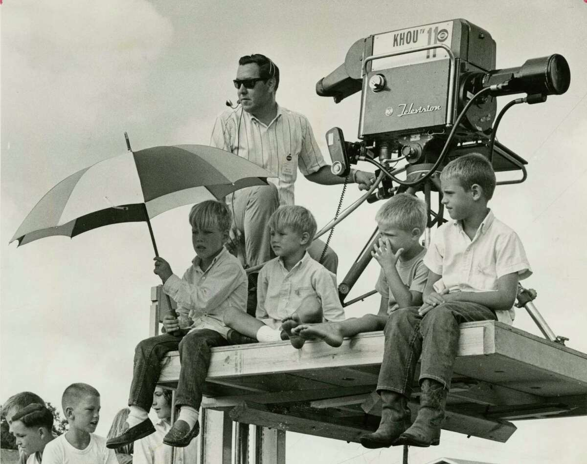 August 21, 1965: Astronaut Pete Conrad's sons - Tommy, Chris, Andrew and Pete - sit atop a KHOU-TV camera stand in their Timber Cove neighborhood following the liftoff of Gemini 5, on which their father was a pilot. The cameraman is Al Varala. (For more photos, scroll through the gallery.)