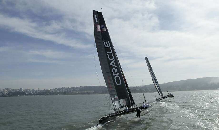 A pair of Oracle Racing AC45's sail in San Francisco, Tuesday, Feb. 21, 2012. The AC45, a 45 foot catamaran, is the official boat of the America's Cup World Series which will race for two seasons before the 2013 events and is the the forerunner to the AC72 that will be sailed in the Louis Vuitton Cup and America's Cup Finals in 2013. (AP Photo/Jeff Chiu) Photo: Jeff Chiu, Associated Press