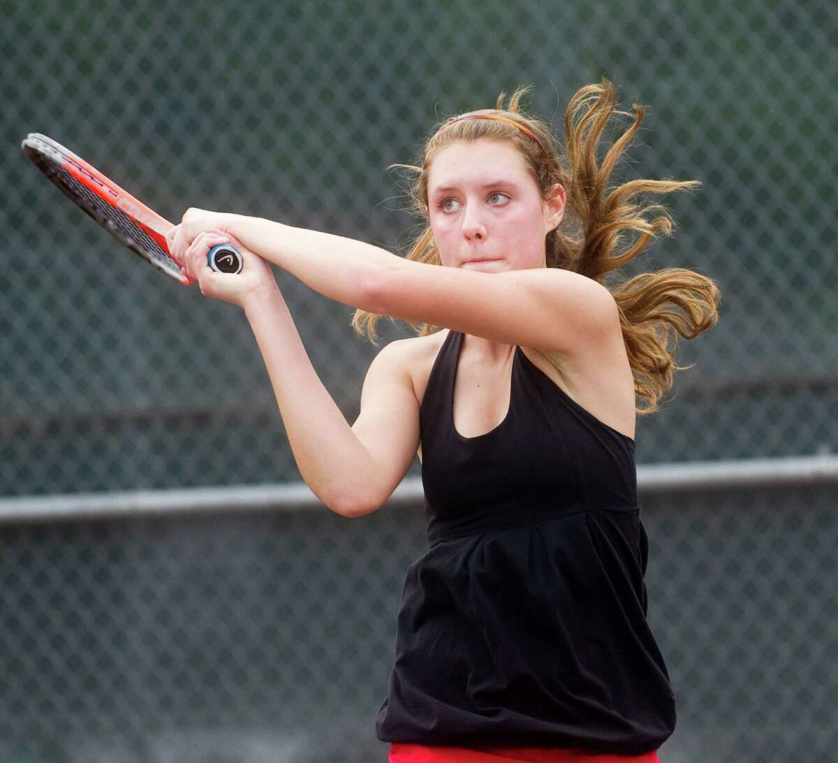 New Canaan's Emily Brand in action during the FCIAC girls tennis championships at Wilton High School in Wilton, Conn., May 24, 2012.