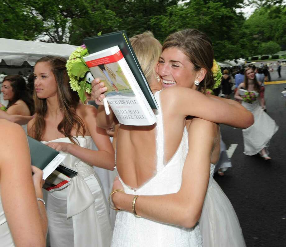 Sarah Brecht, right, of Stamford, hugs a fellow graduate during the conclusion of the the Greenwich Academy Graduation at the main campus in Greenwich, Thursday, May 24, 2012. Photo: Bob Luckey / Greenwich Time