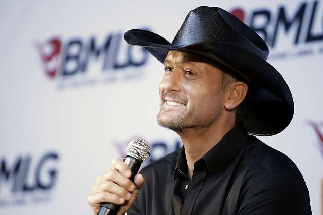 Country music star Tim McGraw speaks during a news conference at the Country Music Hall of Fame and Museum on Monday, May 21, 2012, in Nashville, Tenn. It was announced at the news conference that he has signed a multi-album deal with Big Machine Records, officially ending his rocky relationship with his only previous label, Curb Records. (AP Photo/Mark Humphrey) Photo: Mark Humphrey, Associated Press