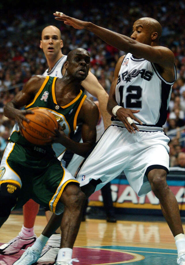 Spurs Bruce Bowen defends seattle Gary Payton during first period at the Alamodome in San Antonio on Friday May 3, 2002.   Spurs Danny Ferry looks on. JERRY LARA STAFF Photo: JERRY LARA, SAN ANTONIO EXPRESS-NEWS / SAN ANTONIO EXPRESS-NEWS