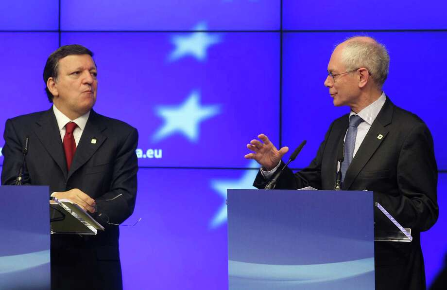 European Council President Herman Van Rompuy, right, and European Commission President Jose Manuel Barroso, address the media at the end of an EU summit, at the European Council building in Brussels, Thursday, May 24, 2012. The leaders of the 27 countries that make up the European Union met in Brussels to try and find a way to keep the debt crisis in Europe from spiraling out of control and promote jobs and growth. Rompuy said that all EU leaders want Greece to remain in the eurozone while respecting its commitments to pay back its debt. (AP Photo/Yves Logghe) Photo: Yves Logghe / AP