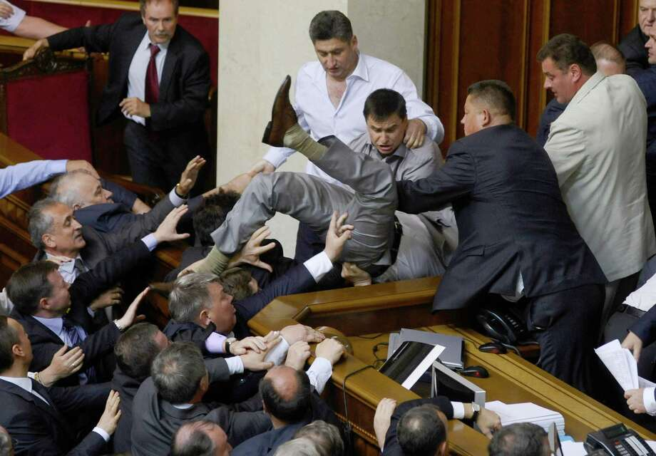 Lawmakers from pro-presidential and oppositional factions fight in the parliament session hall in Kiev, Ukraine, Thursday, May 24, 2012. A violent scuffle erupted in Ukraine's parliament over a bill that would allow the use of the Russian language in courts, hospitals and other institutions in the Russian-speaking regions of the country. Photo: Maks Levin, Associated Press / AP
