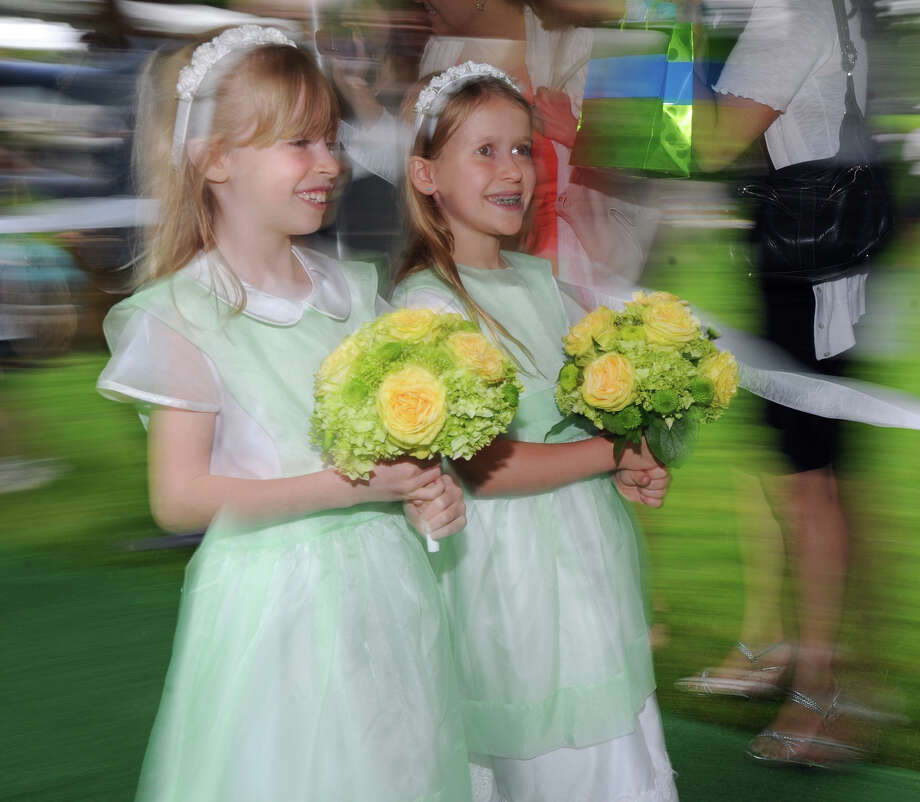 Flower girl Hamilton Doster, left, 8, of Greenwich, during the Greenwich Academy Graduation at the main campus in Greenwich, Thursday, May 24, 2012. Photo: Bob Luckey / Greenwich Time