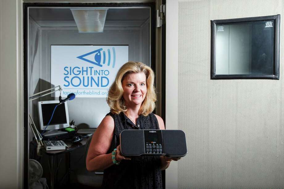 Mary Johnston, an executive at Sight Into Sound, shows off the Narrator, a new radio from Best Buy designed for visually impaired people. Best Buy plans to sell the AM-FM-HD Narrator radio online beginning in July. Photo: Michael Paulsen / © 2012 Houston Chronicle