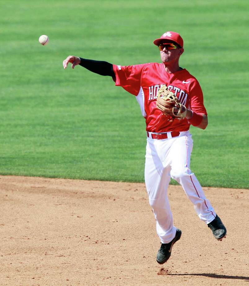 Houston's second baseman Jake Runte relays a throw to home plate against Rice. Photo: Rogelio V. Solis, Associated Press / AP