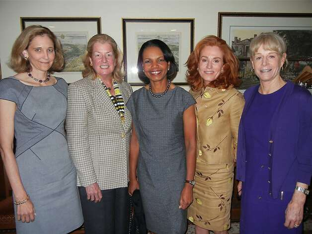 Jennifer Biederbeck (left) with Laura Pfaff, Condoleezza Rice, Brenda Jewet and Chris Boskin at the Monday Group. May 2012. By Catherine Bigelow. Photo: Catherine Bigelow, Special To The Chronicle