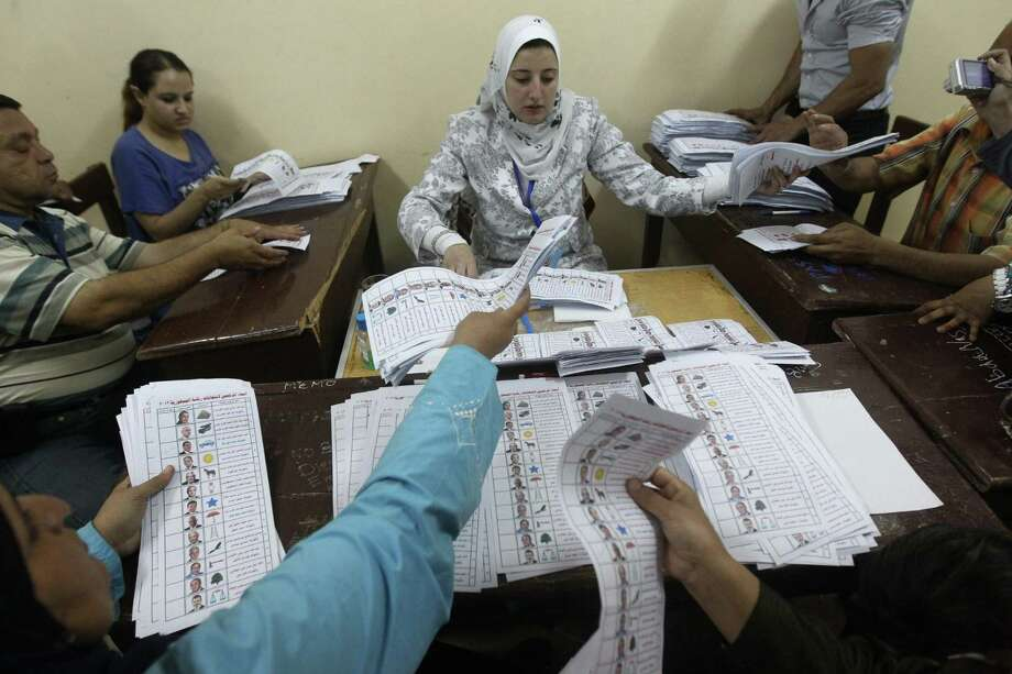 Egyptian election officials count ballots at a polling station in Cairo on May 24, 2012 after polls closed in the country's landmark presidential election. Around 50 million eligible voters were called to cast their ballots in 13,000 polling stations around the country. Photo: KHALED DESOUKI, AFP/Getty Images / AFP
