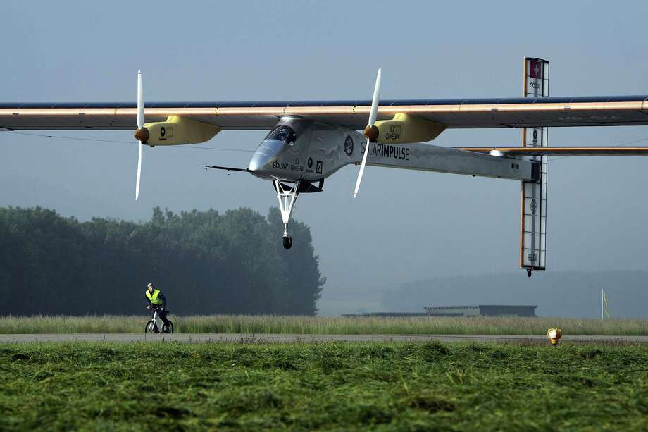 The Swiss sun-powered aircraft Solar Impulse takes off on May 24, 2012 in Payerne on its first attempted intercontinental flight from Switzerland to Morocco. Solar Impulse, piloted by Andre Borschberg, is expected to land in Madrid for a stopover before heading to Morocco without using a drop of fuel. Bertrand Piccard will pilot the second leg on to Rabat, scheduled to leave Madrid on May 28 at the earliest. Photo: FABRICE COFFRINI, AFP/Getty Images / AFP