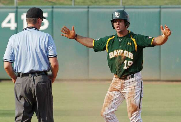 Baylor's Logan Vick (19) reacts after being called out stealing by second base umpire Chris Coskey in the inning of a Big 12 conference tournament baseball game against Oklahoma in Oklahoma City, Thursday, May 24, 2012. Oklahoma won 3-2. Photo: Sue Ogrocki, Associated Press