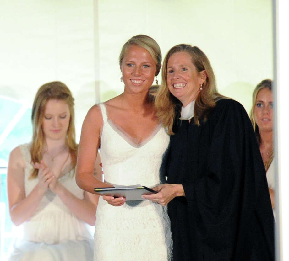 Emily Conway, left,  receives her diploma from Molly King, head of the school, during the Greenwich Academy Graduation at the main campus in Greenwich, Thursday, May 24, 2012. Photo: Bob Luckey / Greenwich Time