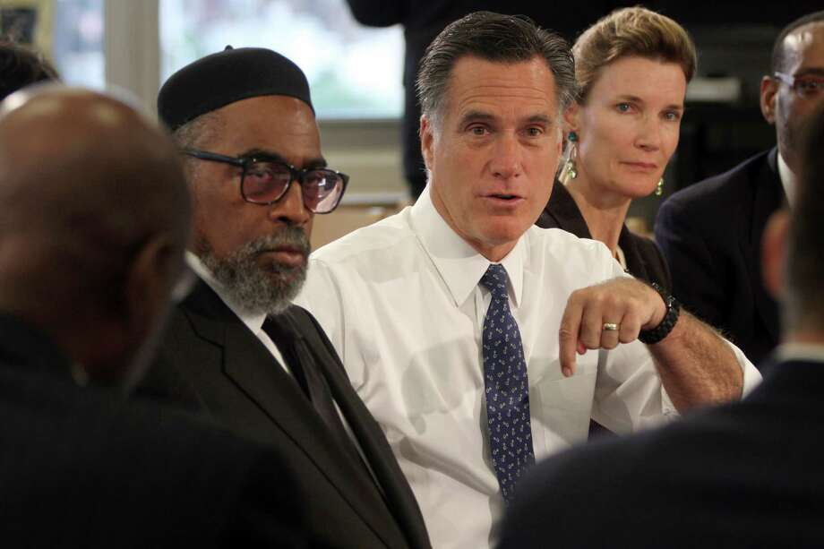 Republican presidential candidate, former Massachusetts Gov. Mitt Romney, center, is joined by the Universal Bluford Charter School founder Kenneth Gamble, left, and Evie Mcniff, during a round table discussion at the school,  Thursday, May 24, 2012, in Philadelphia.  (AP Photo/Mary Altaffer) Photo: Mary Altaffer / AP