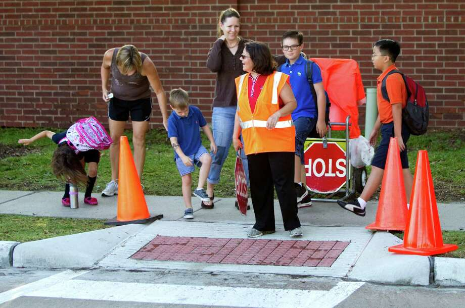 Despite what experts say, school crossing guard Angie Foret says students and parents are slapping and scratching. Photo: Brett Coomer / © 2012 Houston Chronicle