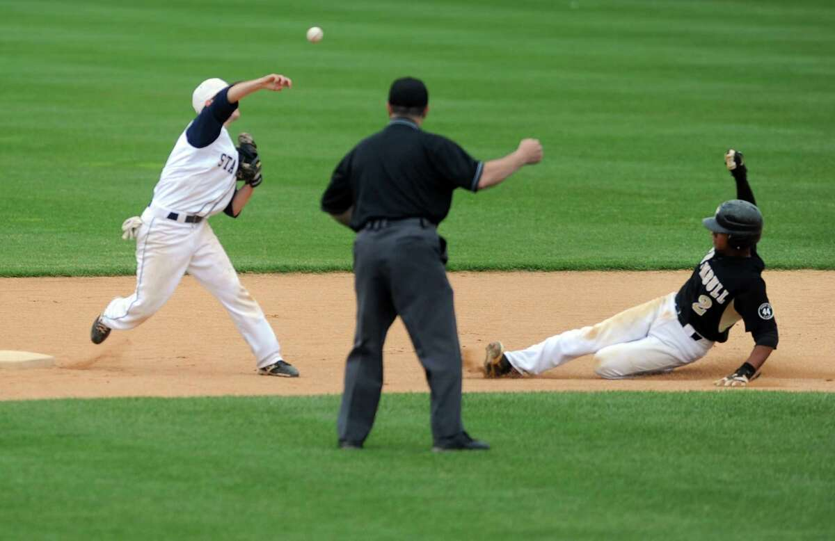 Staple's Benjamin Greenberg attempts a double play as Trumbull's Marcus Jenkins slides to second during the FCIAC baseball semifinals Thursday, May 24, 2012 at the Ballpark at Harbor Yard in Bridgeport, Conn.