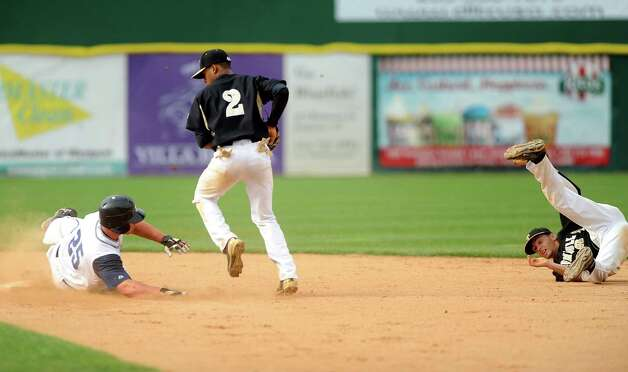 Staples' Zach Levins is safe at second base as Trumbull's Marcus Jenkins catches a pass from teammate Brandon Liscinsky, right, during the FCIAC baseball semifinals Thursday, May 24, 2012 at the Ballpark at Harbor Yard in Bridgeport, Conn. Photo: Autumn Driscoll / Connecticut Post