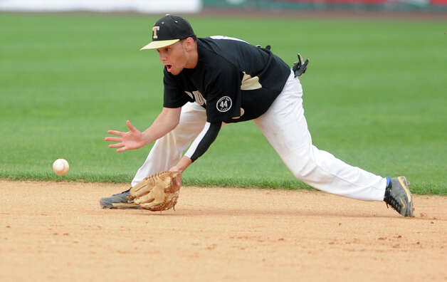 Trumbull's Brandon Liscinsky fields a ground ball during the FCIAC baseball semifinal against Staples High School Thursday, May 24, 2012 at the Ballpark at Harbor Yard in Bridgeport, Conn. Photo: Autumn Driscoll / Connecticut Post