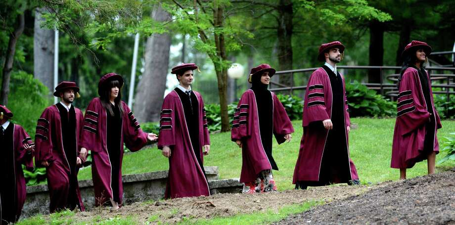 New Medical Doctors march to the Albany Medical College graduation ceremony to commence at the Saratoga Performing Arts Center in Saratoga Springs, N.Y. May 24, 2012.  (Skip Dickstein / Times Union) Photo: SKIP DICKSTEIN / 00017189A
