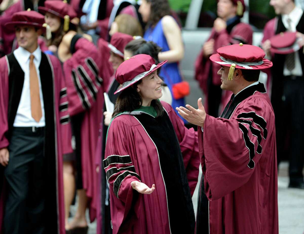 New Medical Doctors greet each other while waiting for the Albany Medical College graduation ceremony to commence at the Saratoga Performing Arts Center in Saratoga Springs, N.Y. May 24, 2012. (Skip Dickstein / Times Union)