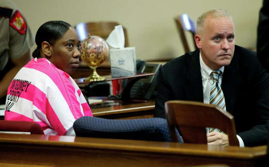 Verna McClain, left, sits in the courtroom with her attorney, Steve Jackson, left, during a hearing Thursday, May 24, 2012, in Conroe. McClain, 30, is charged with capital murder in the death of Kala Golden Schuchardt and the kidnapping her baby. McClain is being held in the Montgomery County Jail without bail. Photo: Brett Coomer, Houston Chronicle / © 2012 Houston Chronicle