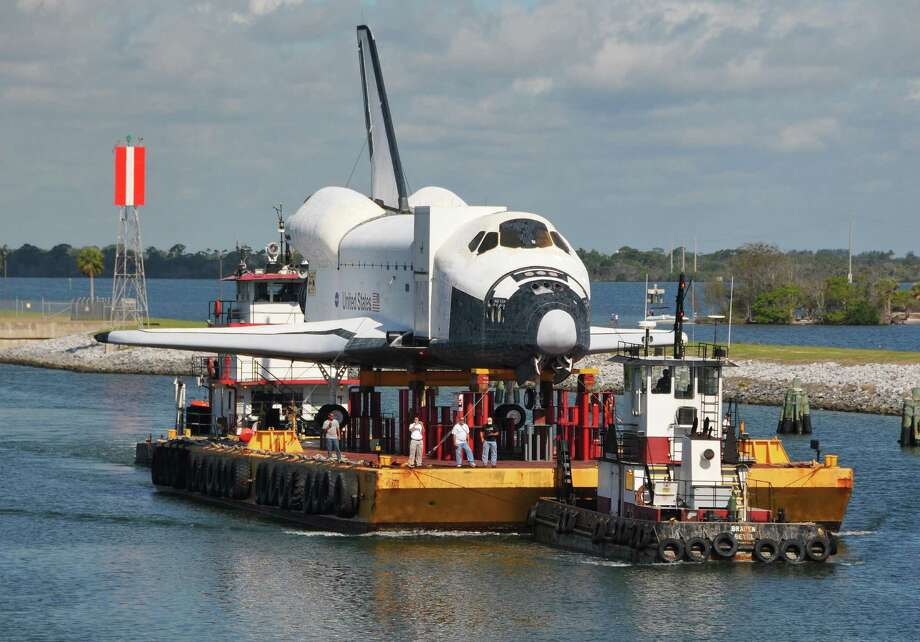 Riding on top of a barge, a full-size replica of the space shuttle departed Kennedy Space Center for Texas last week. Photo: Malcolm Denemark, Associated Press / mags out, internet use ok with mandatory credit