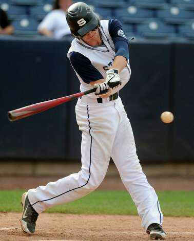 Staples' Matt Reynolds gets a hit during the FCIAC baseball semifinal against Trumbull High School Thursday, May 24, 2012 at the Ballpark at Harbor Yard in Bridgeport, Conn. Photo: Autumn Driscoll / Connecticut Post