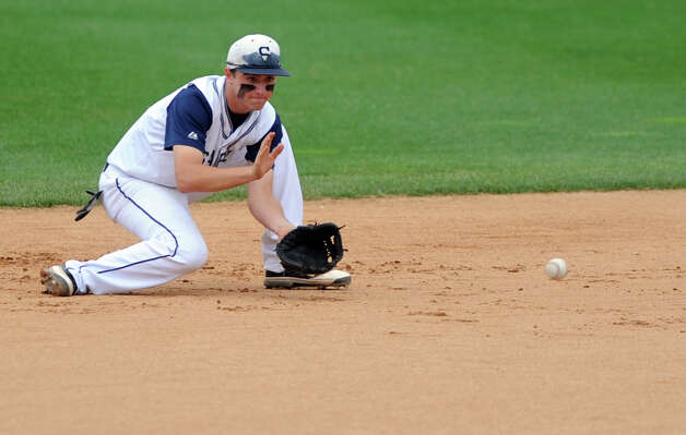 Staples' Benjamin Greenberg fields a ground ball during the FCIAC baseball semifinal against Trumbull High School Thursday, May 24, 2012 at the Ballpark at Harbor Yard in Bridgeport, Conn. Photo: Autumn Driscoll / Connecticut Post