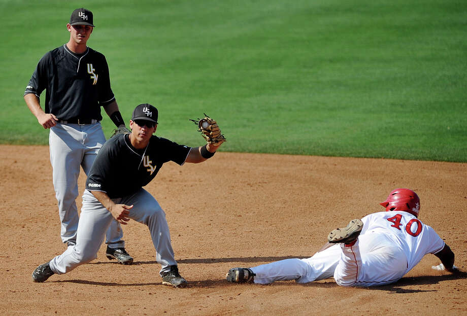 Southern Mississippi's Isaac Rodriguez displays the ball after tagging out Houston's Jonathan Davis at second during their NCAA college baseball game in the Conference USA tournament, Thursday, May 24, 2012, in Pearl, Miss. Southern Mississippi won 8-7. (AP Photo/The Clarion-Ledger, Joe Ellis)  NO SALES Photo: Joe Ellis, Associated Press / The Clarion-Ledger