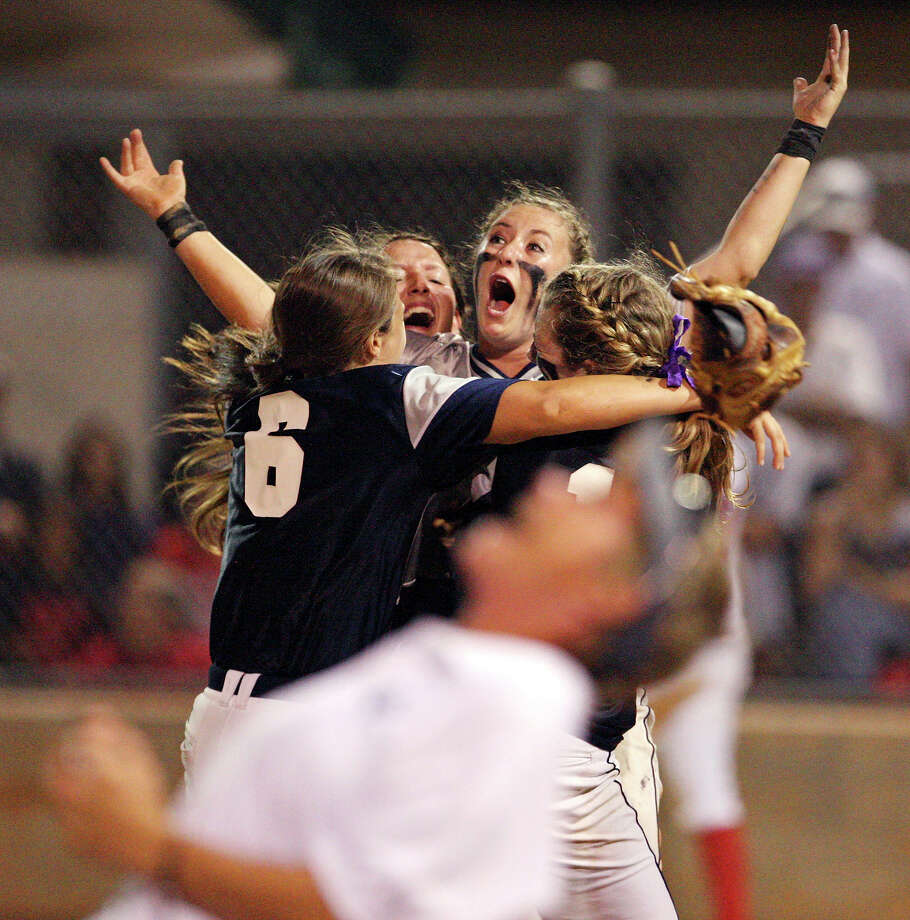 Smithson Valley's Katie Repole (center) celebrates with teammates after getting the final out in the ninth inning. The victory advanced the Rangers to the 4A state tournament. Photo: Edward A. Ornelas, San Antonio Express-News / © 2012 San Antonio Express-News