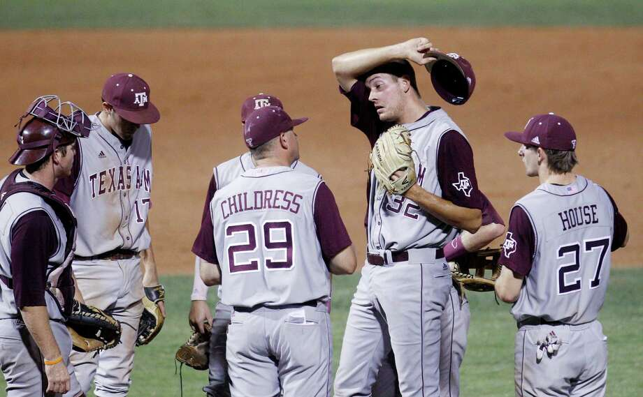 Texas A&M head coach Rob Childress (29) goes out to the mound to talk with pitcher Kyle Martin (32) in the eighth inning of a Big 12 conference tournament baseball game against Missouri in Oklahoma City, Thursday, May 24, 2012. Missouri won 5-3. (AP Photo/Sue Ogrocki) Photo: Sue Ogrocki, Associated Press / AP