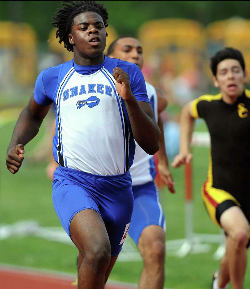 Shaker's Lloyd Smalling reaches the finish line first in a 100-meter-dash trial during the Section II boys track meet on Thursday, May 24, 2012, at Guilderland High in Guilderland, N.Y. (Cindy Schultz / Times Union) Photo: Cindy Schultz / 00017784B