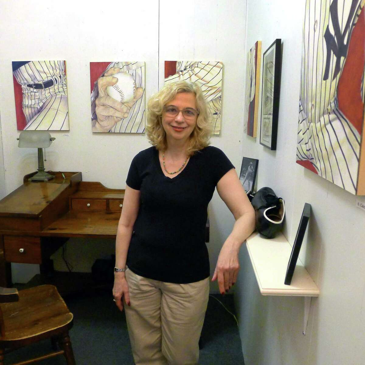 """Artist Lori Barraco Sylvester, who has an exhibit called """"pin stripes"""" featuring a series of painting showing the iconic Yankees uniform in Troy N.Y. Thursday May 24, 2012. (Michael P. Farrell/Times Union)"""