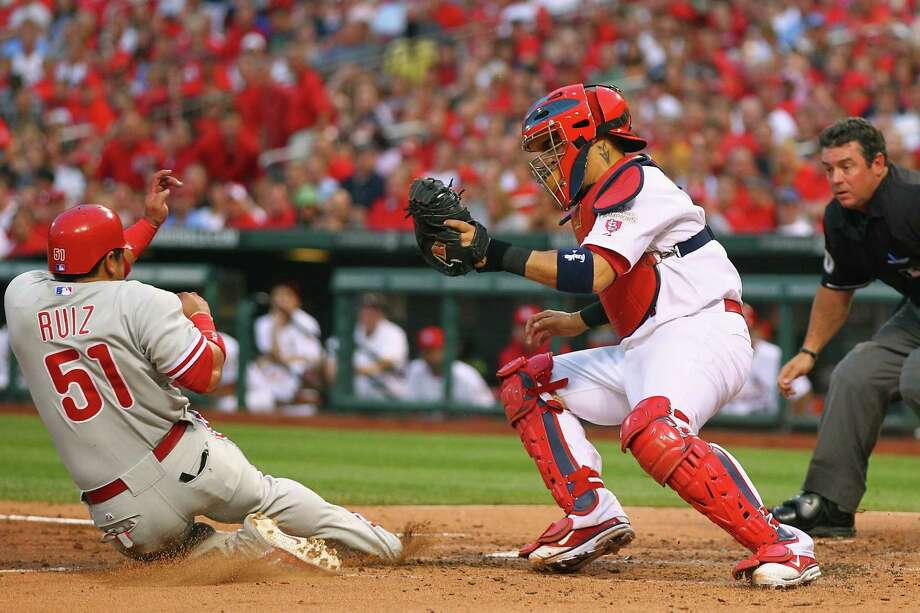 The hits and runs just kept coming in St. Louis on Thursday night, with Carlos Ruiz sliding past Yadier Molina to score one of the Phillies' 10 runs. Photo: Dilip Vishwanat / 2012 Getty Images