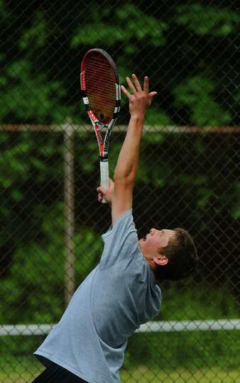 Albany Academy's Stefan Kuhar serves during his Section II tournament semifinal victory over Bethleh