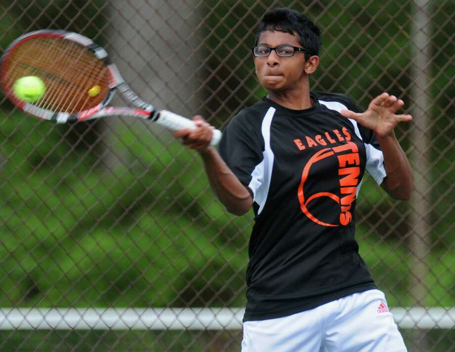 Bethlehem's Rohin Bose hits a forehand during his Section II tournament semifinal loss to Albany Academy's Stefan Kuhar on Thursday May 24, 2012 in Schenectady, NY.   (Philip Kamrass / Times Union ) Photo: Philip Kamrass / 00017800A