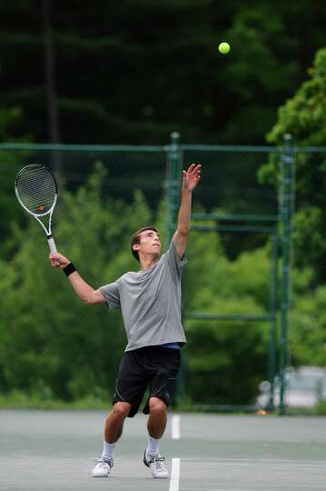 Glens Falls Mitch Burhoe serves during his Section II tournament semifinal loss to Scotia-Glenville'