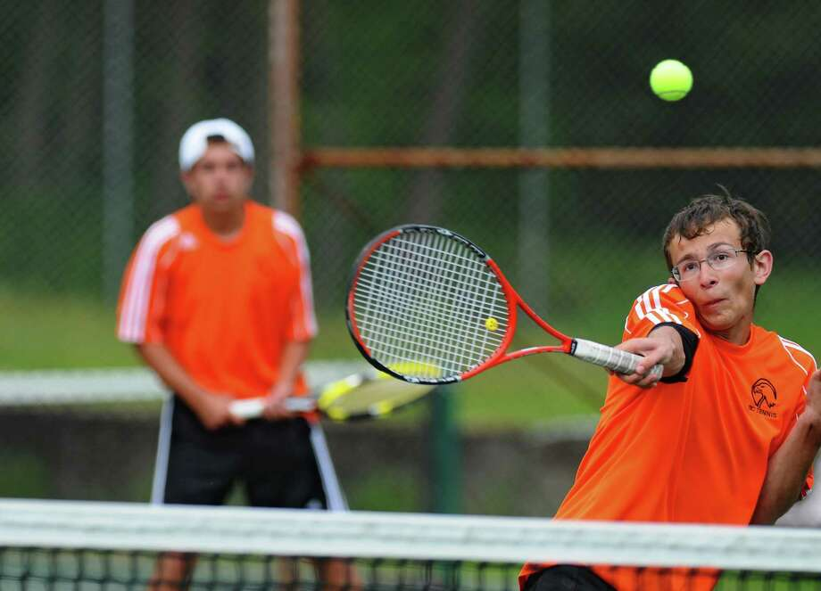 Bethlehem's Nick Mashuta, right,  plays net as he and doubles partner Nick DeLuke, left, defeat Niskayuna's John Finn and Ned Feist during their Section II tournament semifinal on Thursday May 24, 2012 in Schenectady, NY.  (Philip Kamrass / Times Union ) Photo: Philip Kamrass / 00017800A