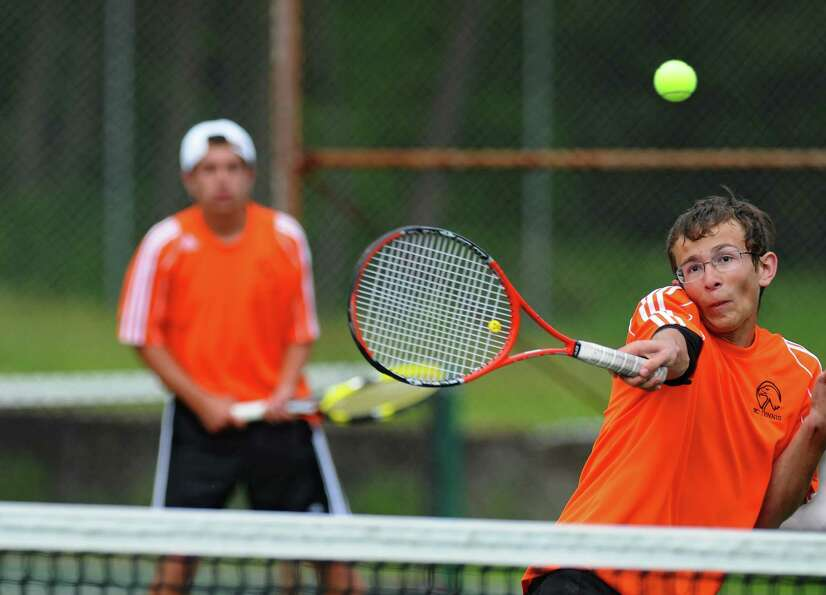 Bethlehem's Nick Mashuta, right,  plays net as he and doubles partner Nick DeLuke, left, defeat Nisk