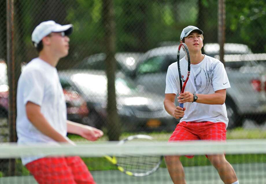 Niskayuna's Ned Feist prepares to return a shot, right, as he and doubles partner John Finn, left,  lost to Bethlehem's Nick Mashuta and Nick DeLuke, during their Section II tournament semifinal on Thursday May 24, 2012 in Schenectady, NY.  (Philip Kamrass / Times Union ) Photo: Philip Kamrass / 00017800A