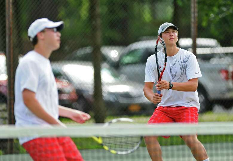 Niskayuna's Ned Feist prepares to return a shot, right, as he and doubles partner John Finn, left,