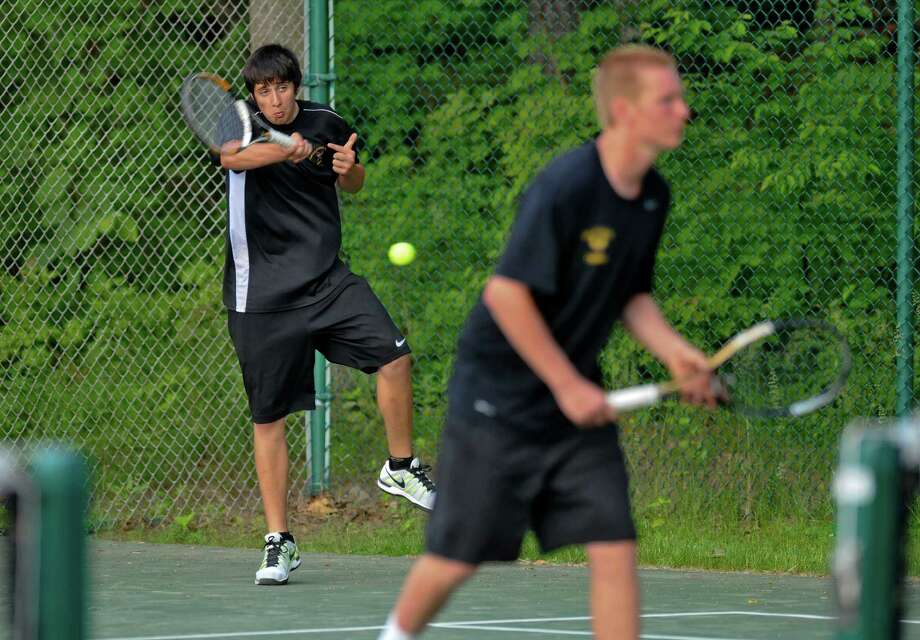 Ballston Spa's Evan Markson, left, returns a shot as he and doubles partner Bryce Recer, right, play Niskayuna's Ned Feist and John Finn during a consolation match following their Section II tournament semifinal losses on Thursday May 24, 2012 in Schenectady, NY.  (Philip Kamrass / Times Union ) Photo: Philip Kamrass / 00017800A