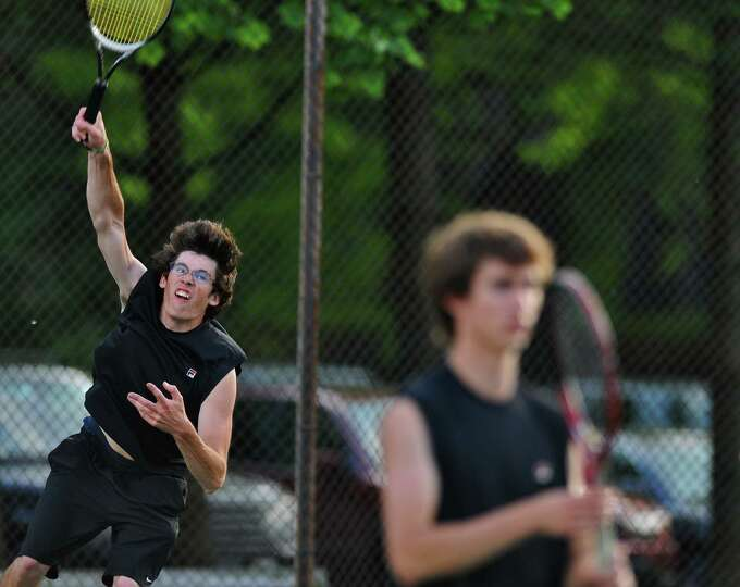 Guilderland's Austin Malerba hits a serve as he and doubles partner Erik Kopff, right, play Bethlehe