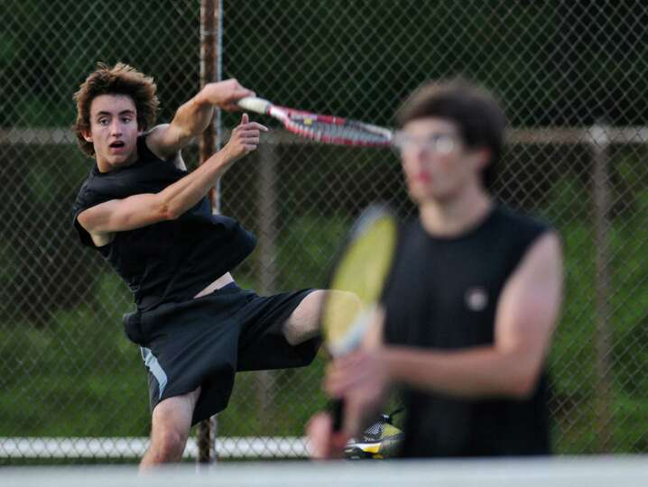 Guilderland's Erik Kopff hits a serve as he and doubles partner Austin Malerba, right, play Bethlehe