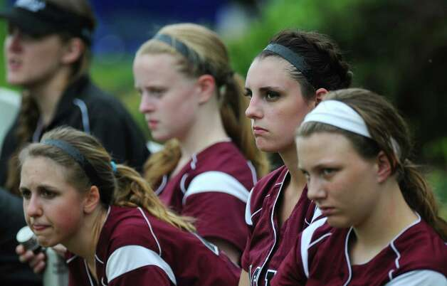 Loudonville Christian's Alex Rollis, second from right, watches her teammates hit during a scrimmage against Albany Academy for Girls on Monday May 21, 2012 in Albany, NY.    (Philip Kamrass / Times Union ) Photo: Philip Kamrass / 00017759A