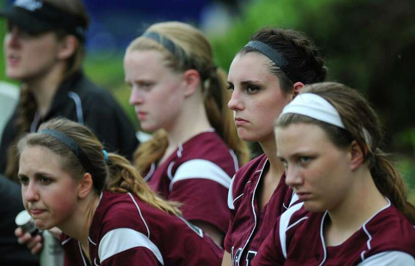 Loudonville Christian's Alex Rollis, second from right, watches her teammates hit during a scrimmage