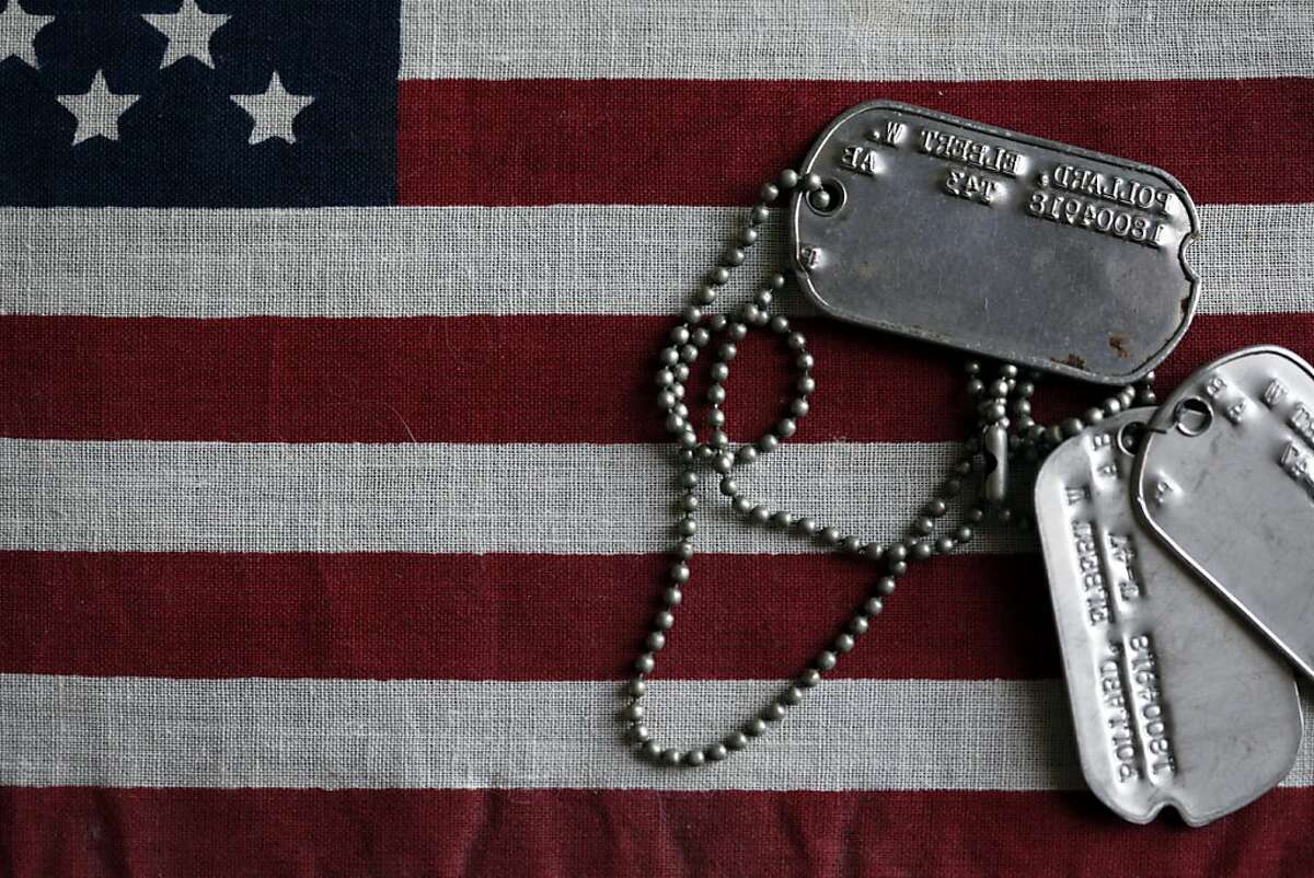 The dog tags of Elbert Pollard are shown in San Francisco, Calif. Thursday, May 24, 2012. Pollard was a 28-year-old Air Force gunner in 1950 when he died parachuting out of a B-36. His remains were finally identified by DNA this year, and Friday they will be laid to rest in the Presidio.